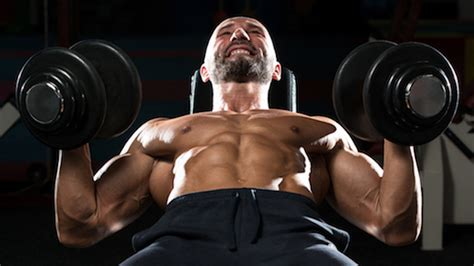 dumbbell bench press variations this dumbbell press variation builds a stronger chest and core stack