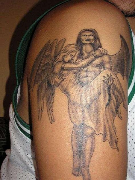 tattoo angel and devil on shoulder angel and devil tattoos on front shoulders real photo