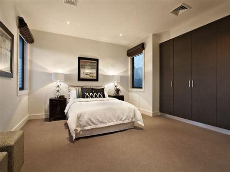 Modern bedroom design idea with carpet amp built in wardrobe using brown