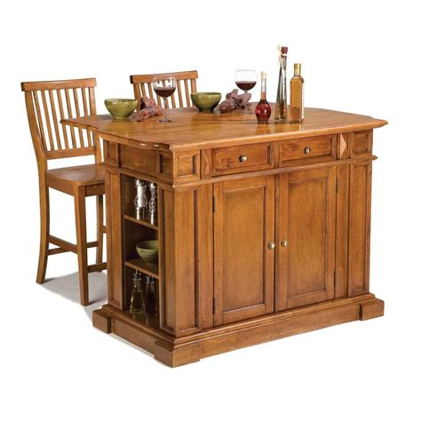 home styles kitchen islands 49 3 4 in kitchen island in cottage oak with two stools 5004 948