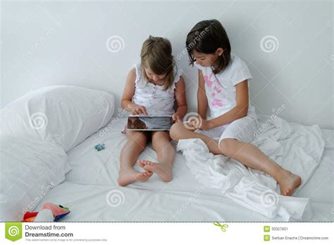 young girls beds children using tablet computer stock image image 33327601