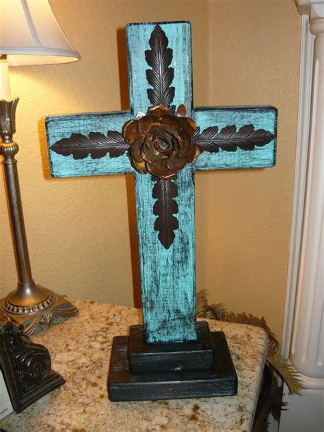 rustic standing wood cross with iron accents and rusty