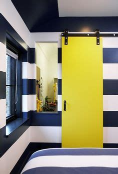 white and navy blue striped wall eclectic bedroom blanco interiores boy s rooms nautical boy bedroom