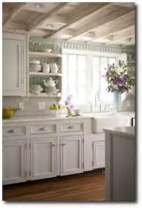 Kitchen with seafoam green painted beadboard walls white kitchen