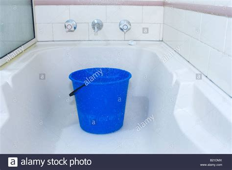 water under bathtub a bucket placed in a bath under the shower to conserve