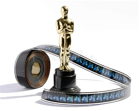 film oscar download replica oscar statue with a roll of movie film stock photo