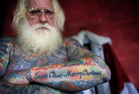 tattooed santa santa claus is coming to town and he s covered in
