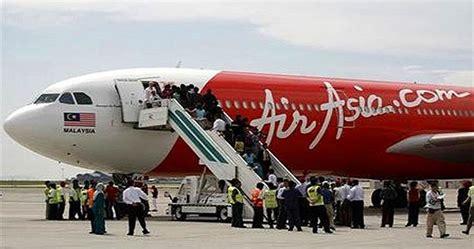 airasia kuala lumpur to jakarta airasia staff suddenly dies while on duty during flight