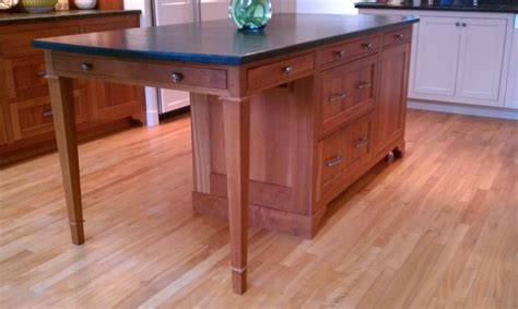 kitchen island table legs 20120204beautiful seating island inspiredfurnituretable