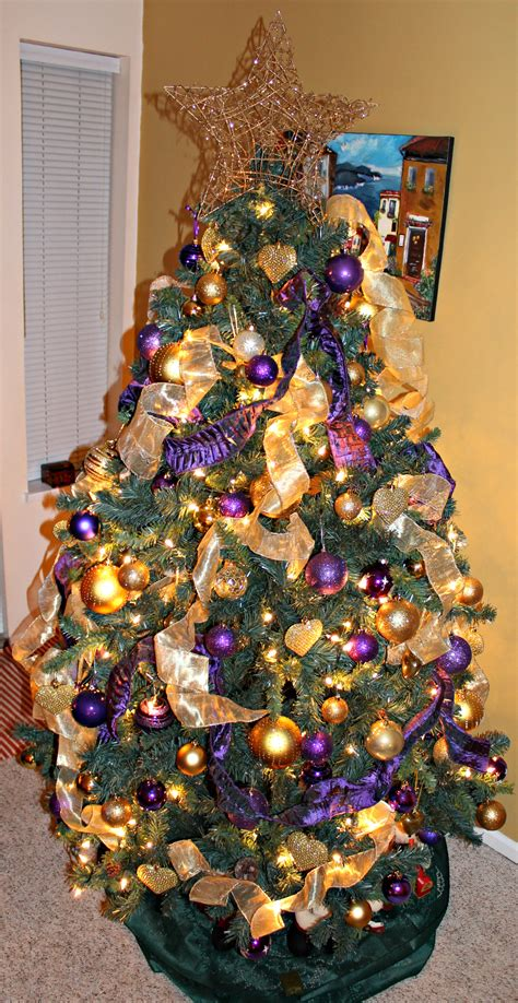 christmas tree decorated in gold and purple www