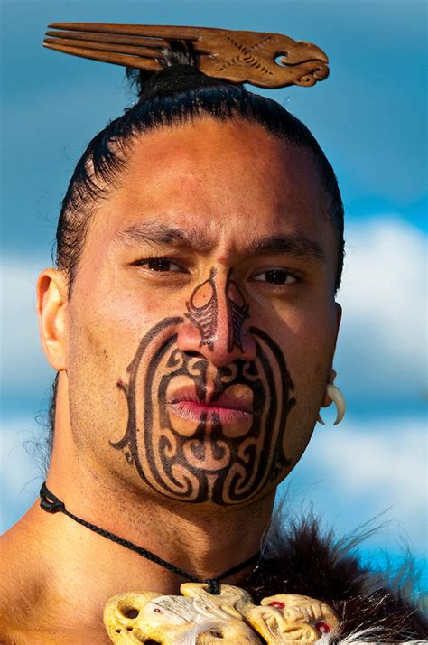 tattoo new zealand ta moko a maori warrior with a ta moko facial tattoo performs a