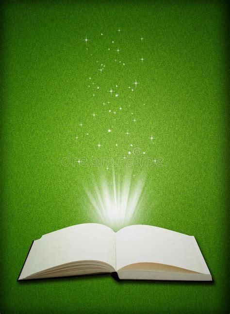 open book magic  green grass background stock