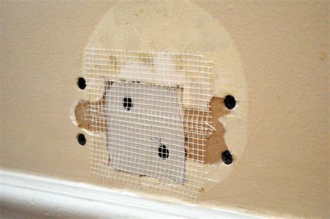 Small D Patch On Interior Wall by How To Repair A Medium Size In Drywall One Project