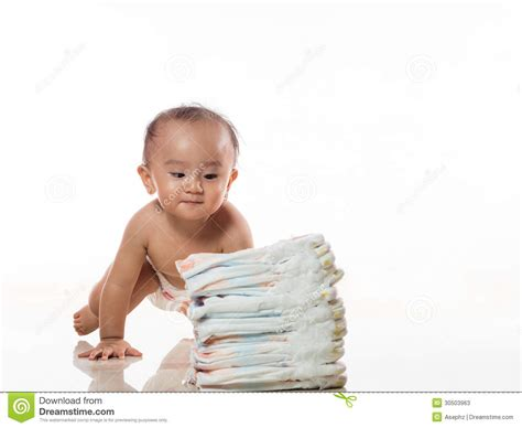 a small child in a nappy plays with the lock to a beach hut on the baby play with diaper stock photos image 30503963