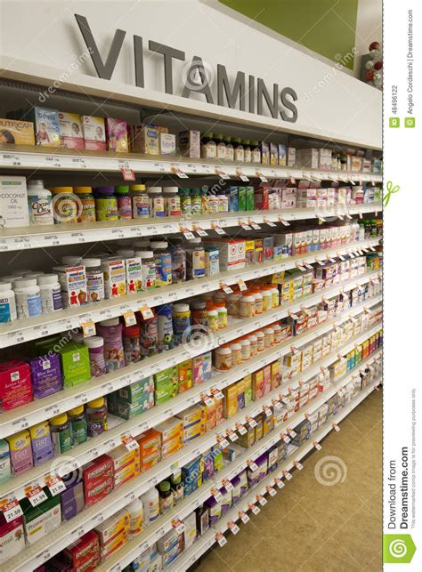Shelf Of Product by Vitamins Shop Shelves Pharmaceutical Products Editorial