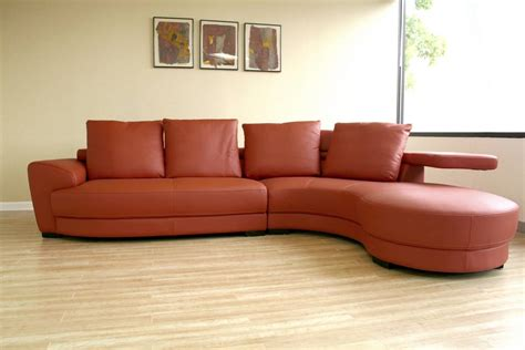 Decorate Coffee Table The Incredible Effect Of A Curved Leather Sofa Upon Your