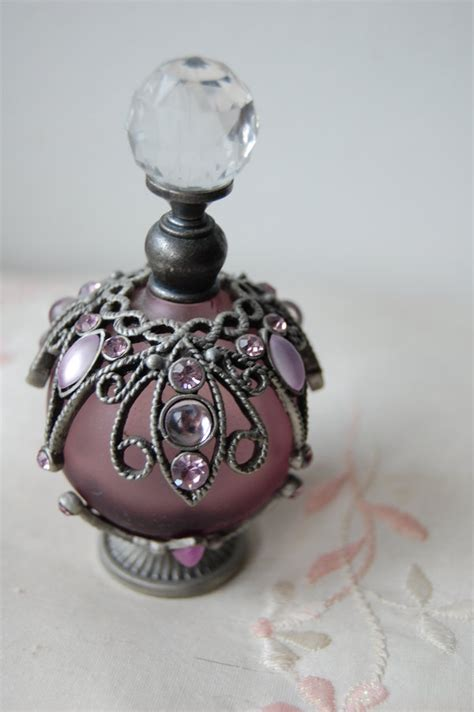 a perfume bottle by tha butterfly effect on deviantart