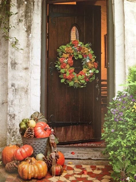 Front Door Fall Decorations Autumn Welcome A Rustic Front Door And A Gorgeous Wreath And Pile Of Pumpkins Welcome Visitors