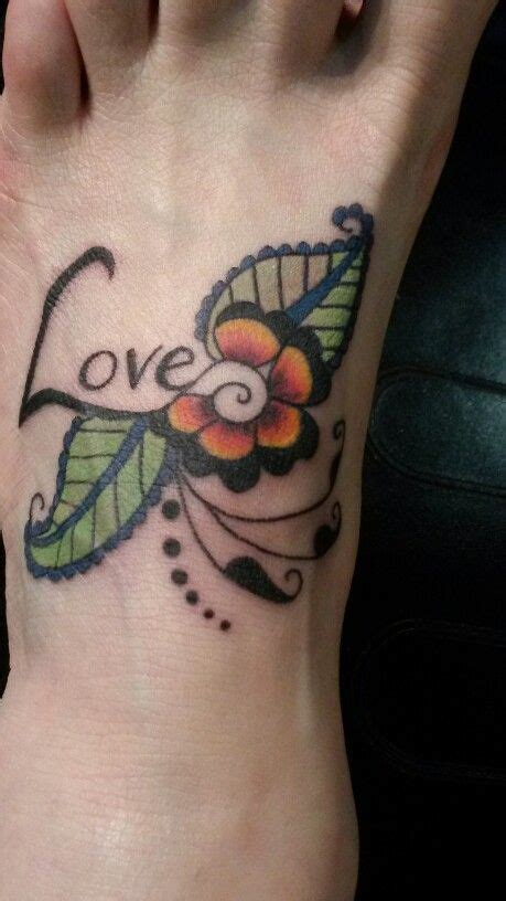 henna mehndi inspired love tattoo design in the skin