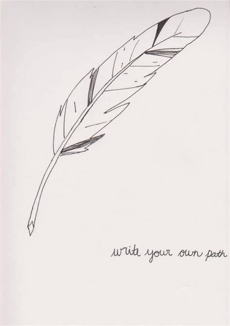 tattoo with pen ink feather quill pen writing with a feather quill
