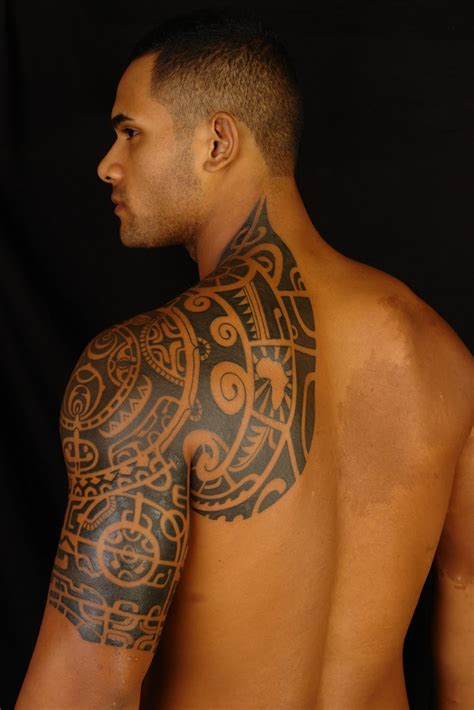 body tribal tattoo of the rock chest tattoomagz