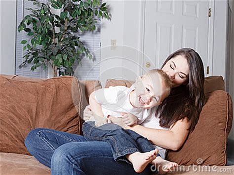 mom son couch mom and toddler fun tickle play royalty free stock images