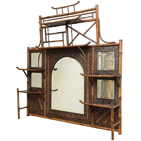 19th century bamboo mirror and shelf unit at