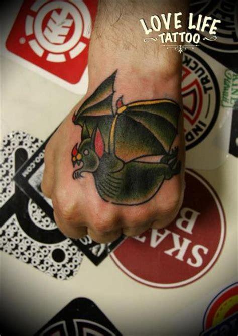 old school tattoo in hand old school hand bat tattoo by love life tattoo