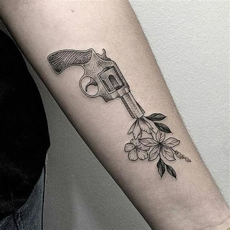 tattoos of guns gun shooting flowers by marla moon