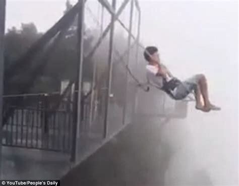 cliff swing thrill seeker rides a swing on the edge of a 1 000 foot