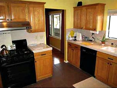 Wood Cabinets With Black Appliances by Wood Kitchen Black Appliances Before Hooked On Houses