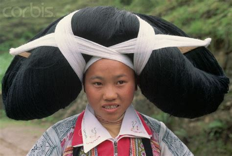 ox horn hairstyle hipster hair china a woman from the long horn miao tribe wears a