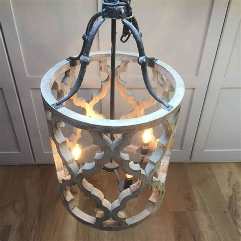 wood and metal chandelier carved wood and metal ikat design pendant chandelier by