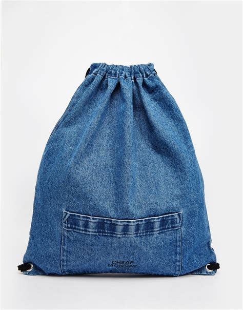 Bag Denim cheap monday cheap monday denim drawstring bag at asos
