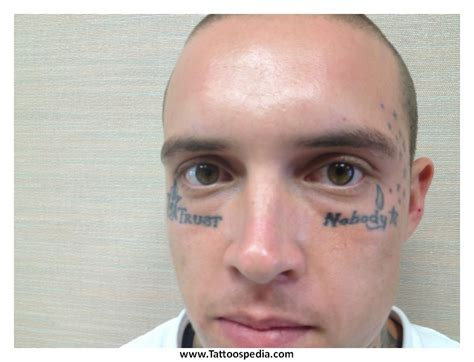 tattoo cross under eye meaning star tattoo near eye star tattoos under eyes 5