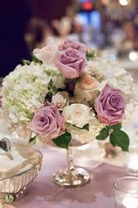 roses centerpieces pastel purple roses and white hydrangea centerpiece in a