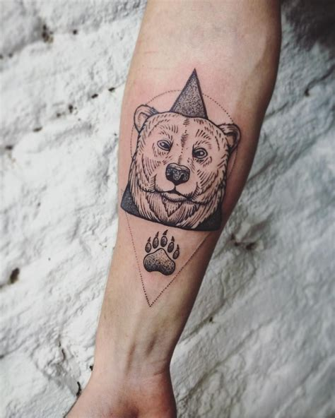 bear tattoo meaning amazing lined and geometric on the forearm