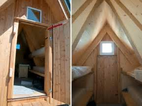 wooden a frame cabin crowns alpine mountaintop