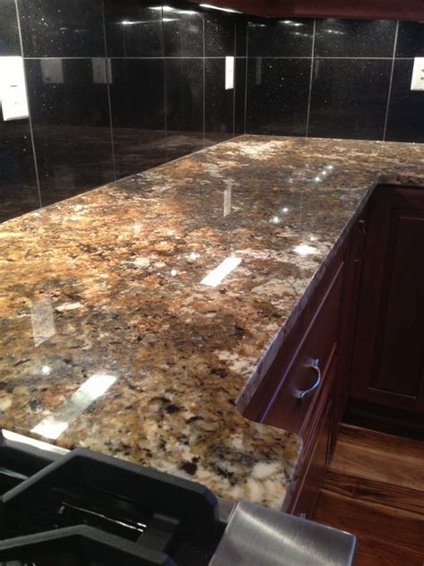 All About Granite Countertops by Carnival Granite With Black Galaxy Island And Black Galaxy 12x12 Tiles