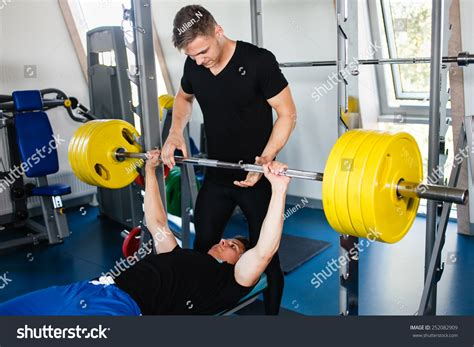 bench press assistance exercises bench press workout personal trainer stock photo 252082909
