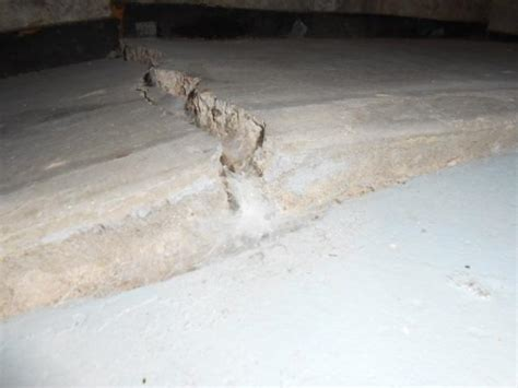 basement floor heaving rooms