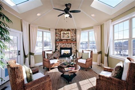 sunroom with fireplace this sunroom features a stone fireplace with a wood mantel