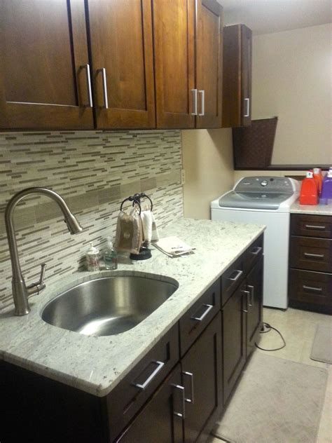 How To Install Kitchen Backsplash Glass Tile white cabinets what color granite countertop and