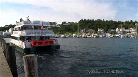 boat r five dock five minutes on mackinac ferry boats arriving at the