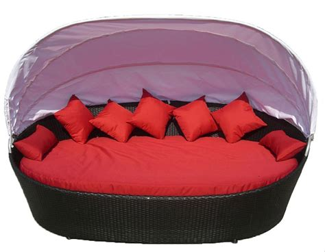round outdoor chaise lounge cushions round black wicker chaise lounge with red cushions and