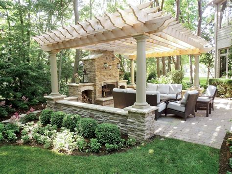 backyard area designs stonework accents this pergola for an outdoor seating area