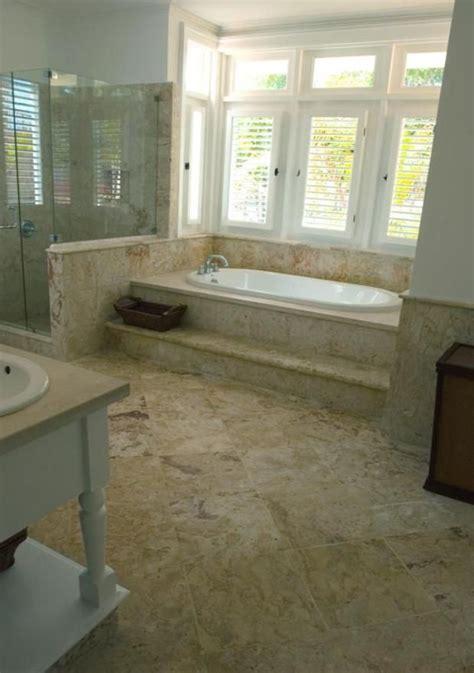 coral stone master bathroom   step ledge