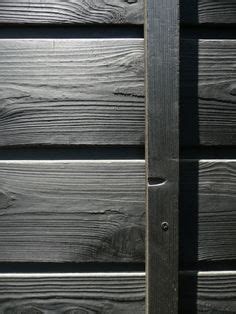 Burning Wood Siding To Preserve - carbonised decking styled from the traditional japanese