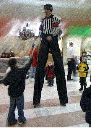 Walker Furniture Christmas Giveaway - stilt walkers pop events group