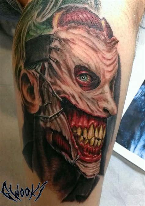 Joker Zombie Tattoo | joker face in bat tattoo on girl upper back